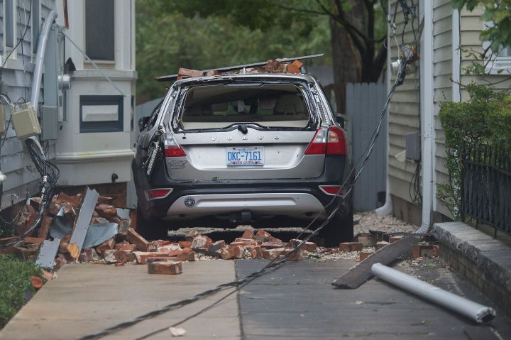 A car is destroyed by falling bricks in Wilmington.