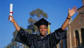 PERBE081 Young man celebrating college graduation,