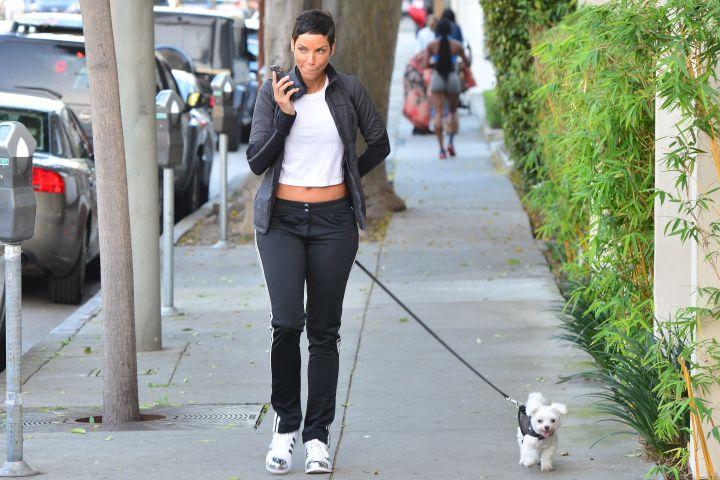 She even looks fabulous when she walks her pup
