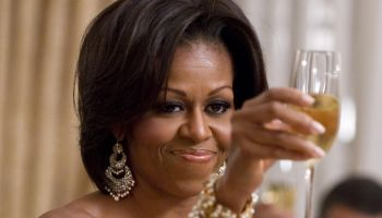 First Lady Michelle Obama raises her gla