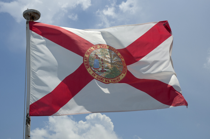 Florida State flag flying from boat.