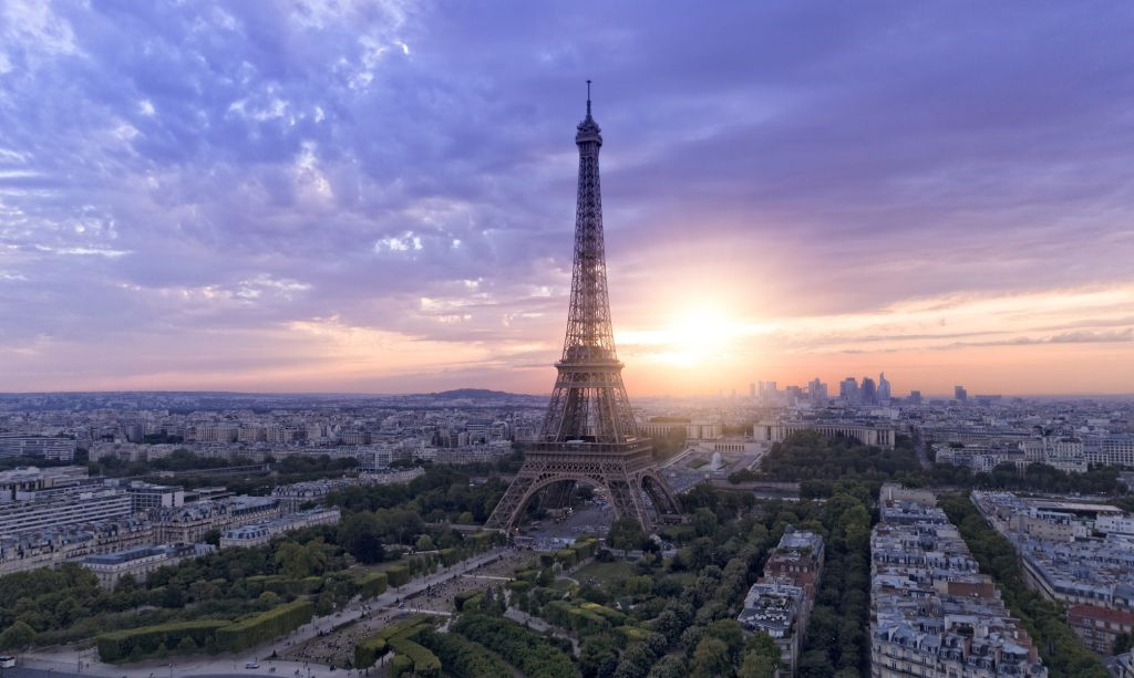 Aerial view of Paris skyline with Eiffel tower during sunset
