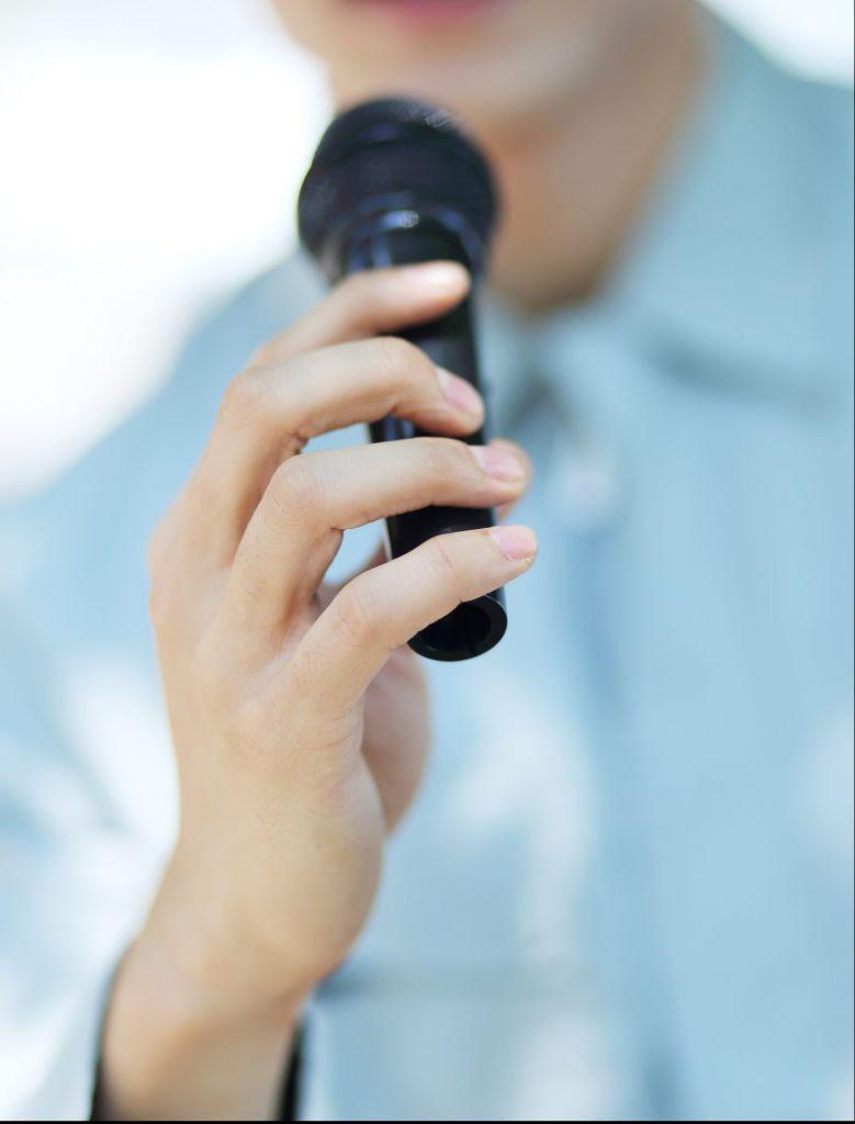 Businessman holding microphone