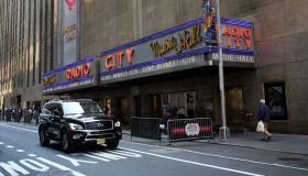 Black car driving by the Radio City Music Hall, Rockfeller Center, Midtown Manhattan, New York City