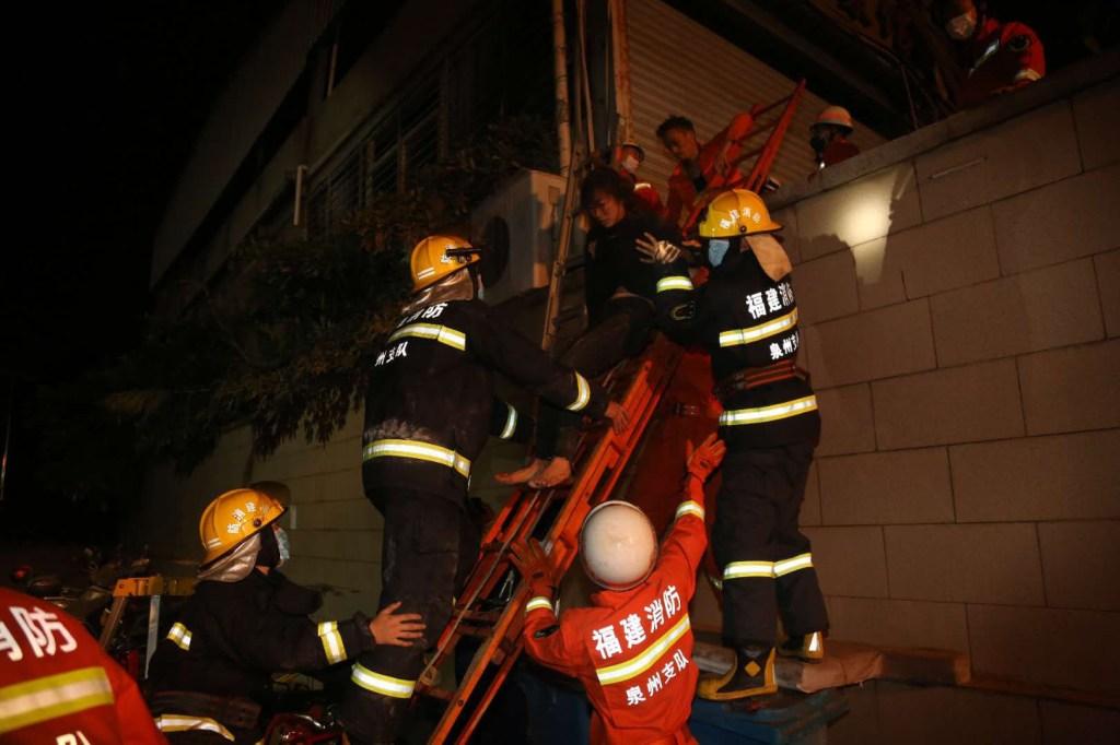 RESCUE WORKERS AT CHINA QUANZHOU HOTEL BUILDING COLLAPSE CORONAVIRUS QUARANTINE