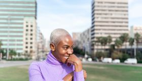 Portrait of smiling white haired woman in the city