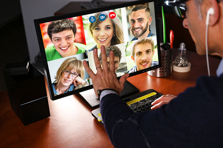 Man Video Chatting with a group of people