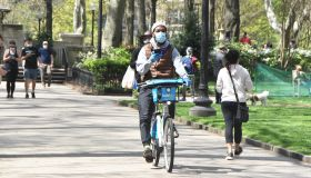 People enjoy the spring weather while maintaining social-distancing in Philadelphia, United States during the Covid-19 pandemic
