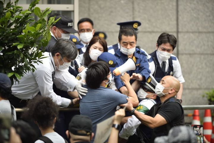 People protest against police violence in Tokyo...