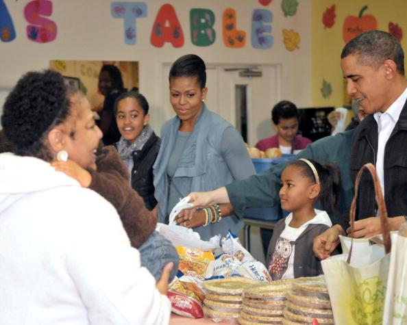 Obama Family Distributes Food At Martha's Table