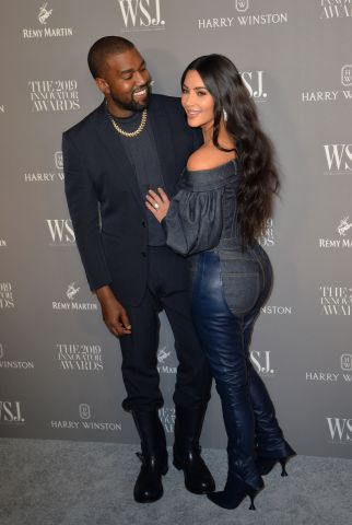Kanye West, Kim Kardashian West at arriv...