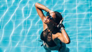Young Black woman at resort pool