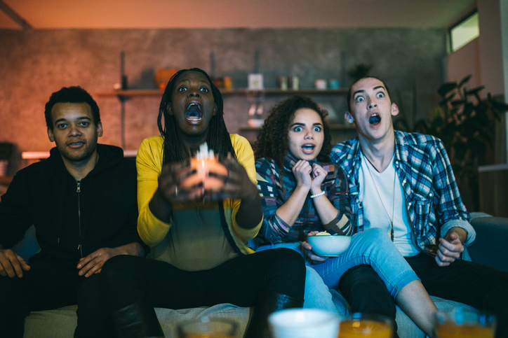 Scared friends watching horror