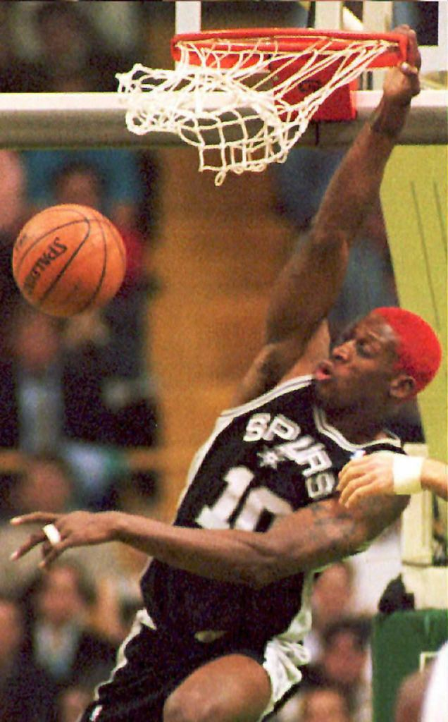 Dennis Rodman (#10) of the San Antonio Spurs slams