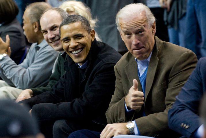 US President Barack Obama sits courtside