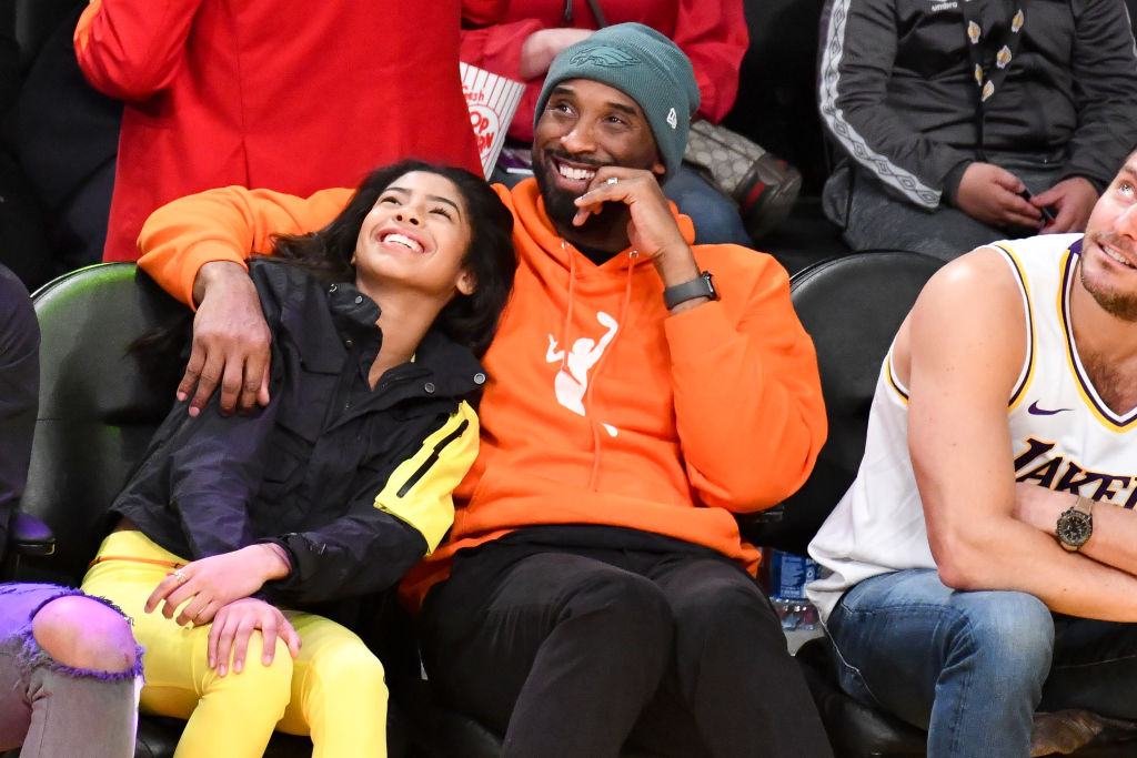 Gianna and Kobe Bryant smiling at 2019 Los Angeles Lakers Game