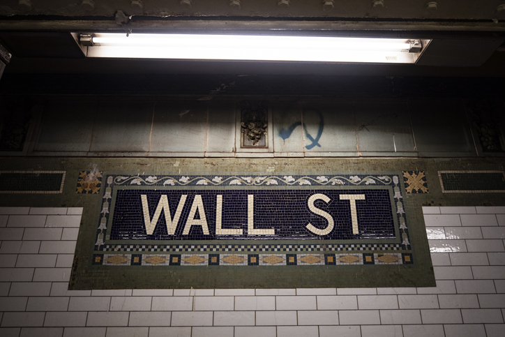 Wall Street sign in NYC train station