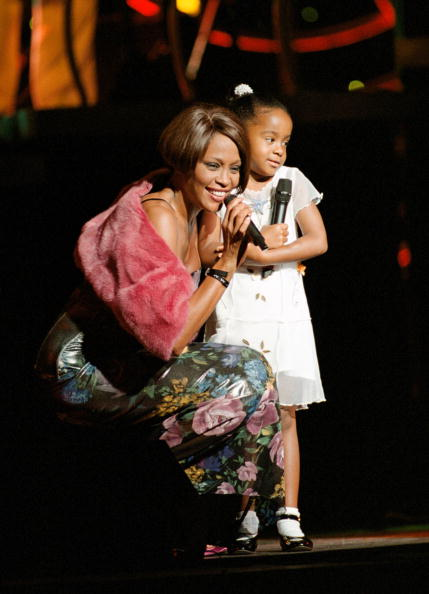 Whitney Houston & Daughter Bobbi Kristina on stage during 1999 concert in NYC.