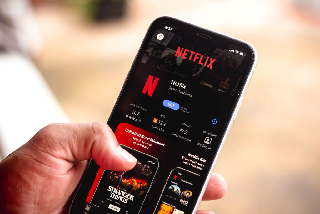 In this photo illustration the Netflix logo in App Store...