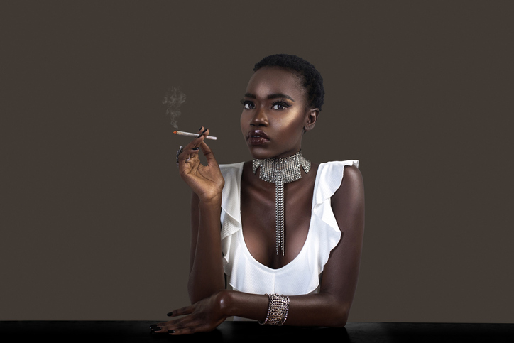 Joint Smoking Stylish Black Lady in Silver Jewelry