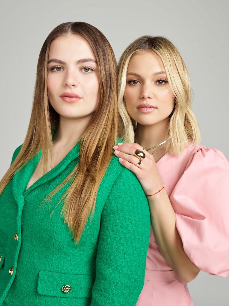 Cruel Summer stars Chiara Aurelia and Olivia Holt pose for a portrait together.