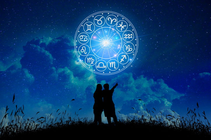Lovers stand in the stars zodiac signs inside of horoscope circle. Astrology in the sky with many stars and moons astrology and horoscopes concept